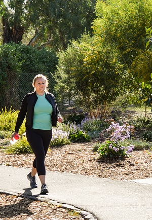 Young woman walking for fitness
