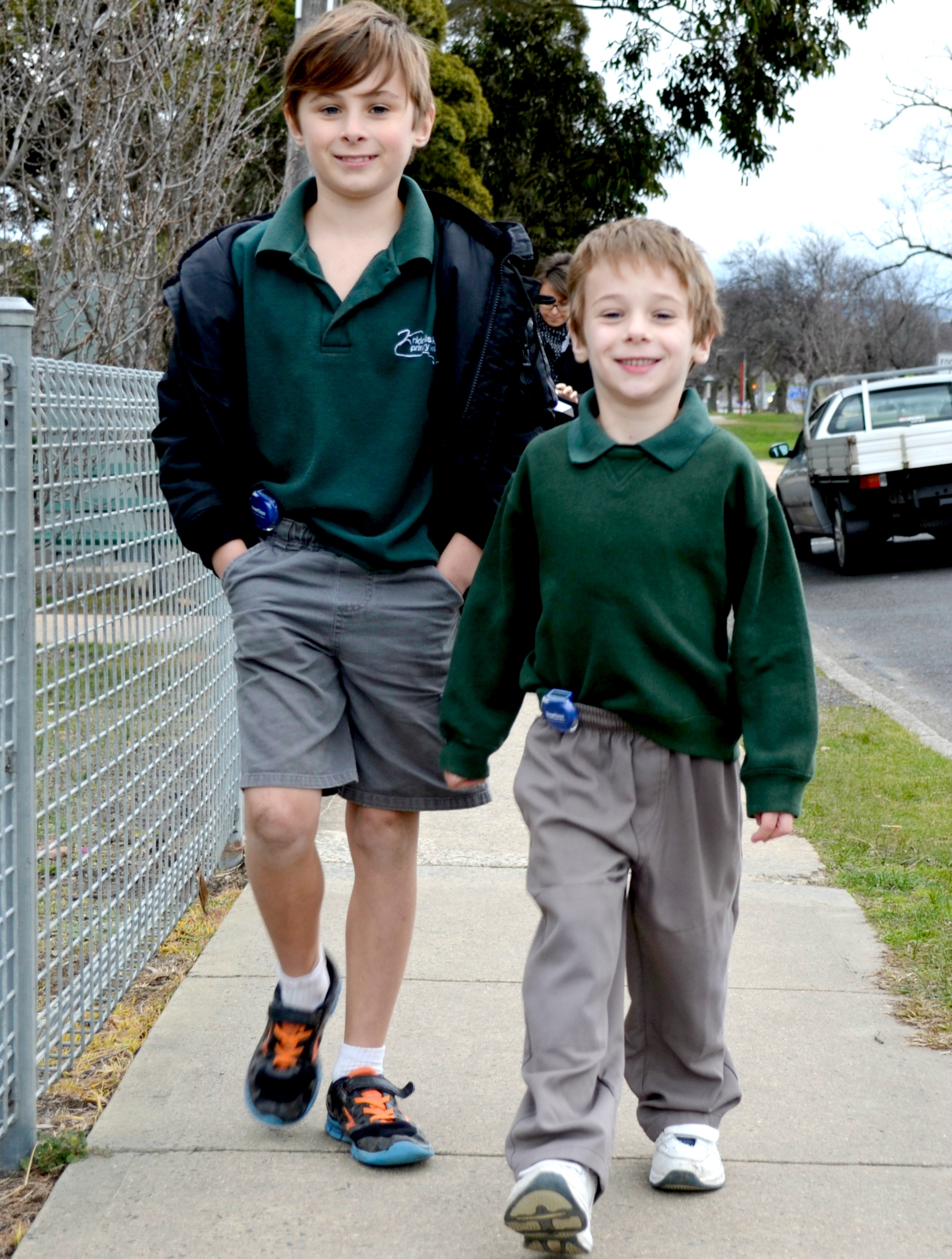 Boys walking with pedometers